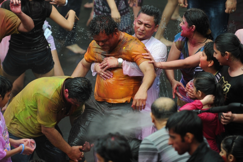 "Revellers celebrate ""Holi"" in Hong Kong on March 31, 2013. Holi, the festival of colours where people smear each other with coloured powder and water, is celebrated by Hindus across the world."
