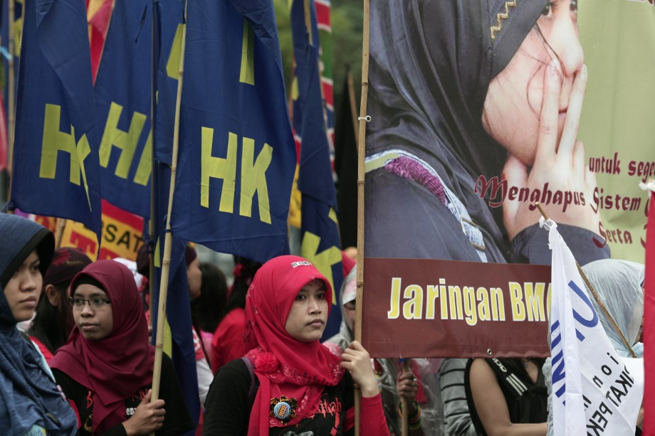 Foreign domestic helpers take part in a May Day rally in Hong Kong on May 1, 2013.