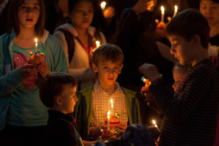 Children hold Christingles, meaning 'Christ Light', as they sing during a festive church service on Christmas Eve in Hong Kong.