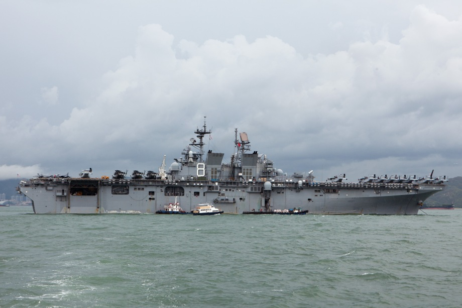The USS Makin Island ship is seen anchored in Hong Kong waters on August 20, 2014. Makin Island (LHD-8) a Wasp-class amphibious assault ship and the second ship of the US Navy to be named Makin Island, was laid down on February 14, 2004 by the Ingalls Shipbuilding, Pascagoula, Mississippi and was christened on 19 August 2006. AFP PHOTO / ANTHONY WALLACE