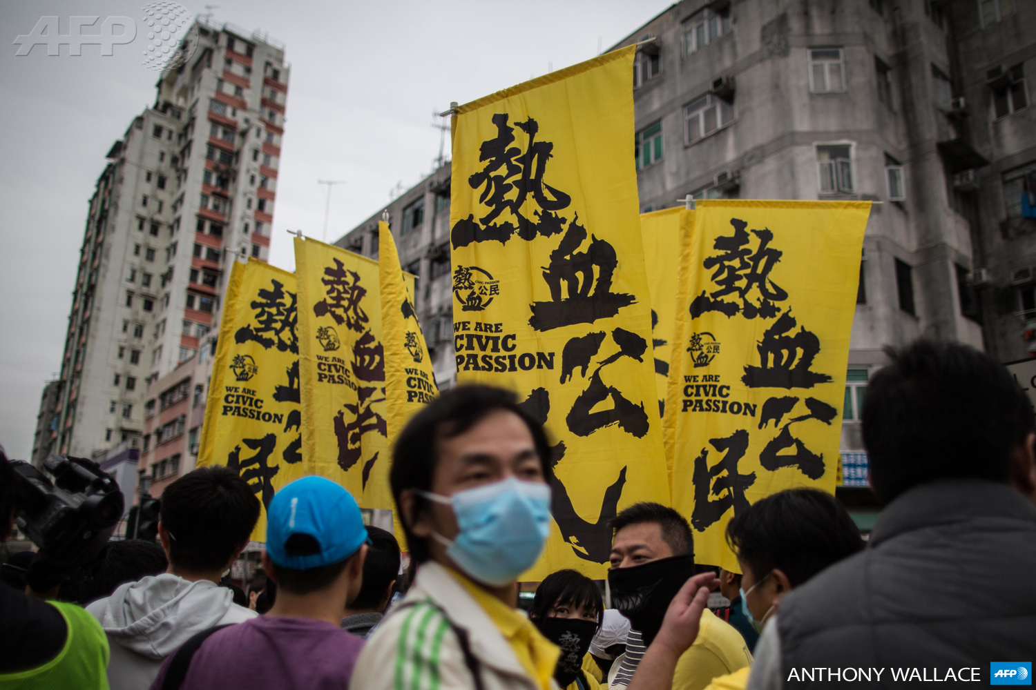 Members of the Civic Passion group hold flags as they attend an anti-parallel trading protest in the Yuen Long district of Hong Kong on March 1, 2015.