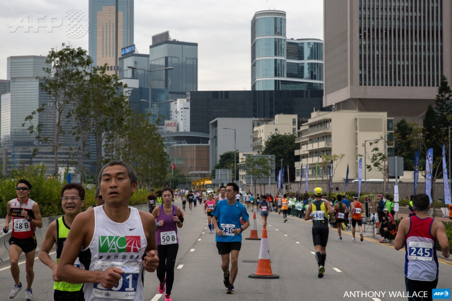 Competitors run in Hong Kong's first inner city ultra marathon on March 1, 2015.