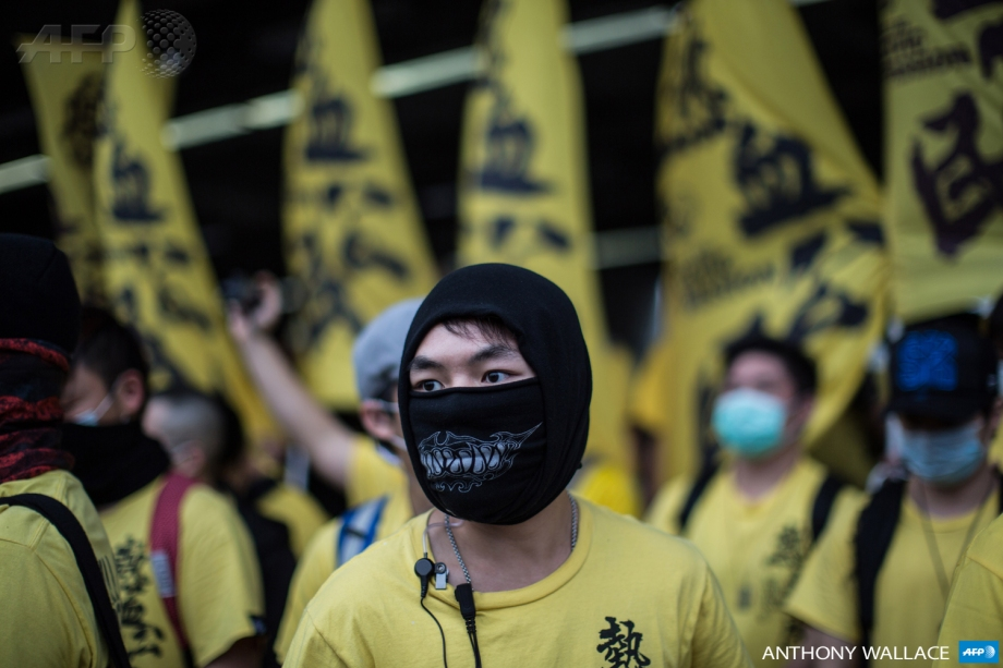 A member of the Civic Passion group looks on as he and other members attend an anti-parallel trading protest in the Yuen Long district of Hong Kong on March 1, 2015.