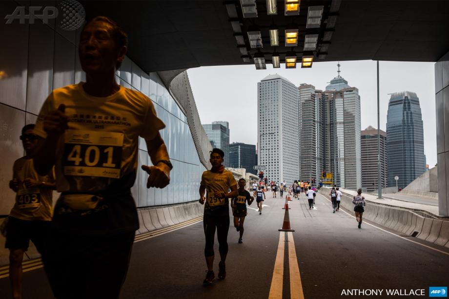 Competitors run through an underpass during Hong Kong's first inner city ultra marathon on March 1, 2015.