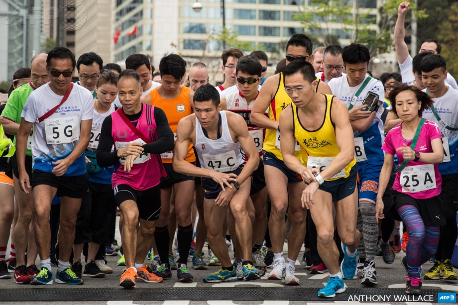 Competitors start a relay race along the same course as Hong Kong's first inner city ultra marathon on March 1, 2015.